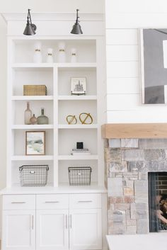 gorgeous white built-ins for my tiny house — great  way to add storage space into the living room