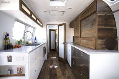 I like the 2 doors, the long countertop and the inset shelves by the door.