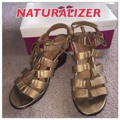 Naturalizer Gladiator Style Wedges Worn once. Size 8US wide. Super comfy! Style is ONWARD, GOLD 22. Gold leather with dark brown hard rubber wedge heels and soles for stability and non slip. Back velcro adjustable strap to get in and out and for customized fit on ankle. Comes in original box. Paid $110 a few months ago. Perfect condition! Naturalizer Shoes Wedges