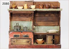Ladenburger Spielzeugauktion GmbH  (Dollhouse kitchen, France, fireplace, sink with water supply, 63 cm wide, 59 cm high, with accessories, ceramic pieces and some parts of tinplate)