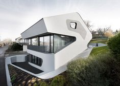 This is the OLS House designed by architectural studio J. Mayer H. and built near Stuttgart, Germany. It's supposed to like a dinosaur head.