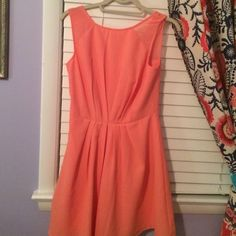 Designer Peach Dress from Urban Chic This peach Fable Dress from Urban Chic is incredibly upscale. Looks great on petite and athletic body types. Awesome for any sophisticated event or date night. Size small. Lightly worn. Mint condition. Fable  Dresses Midi