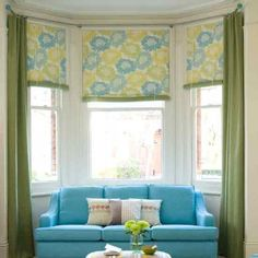 Dressing a bay window by combining curtains and roller blinds ...