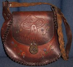 The leather bags and the hand-tooled mushroom motifs...