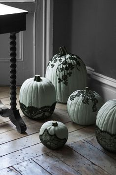 Part cobweb, part creeping vine, the effect of black lace on these painted pumpkins is thoroughly macabre.