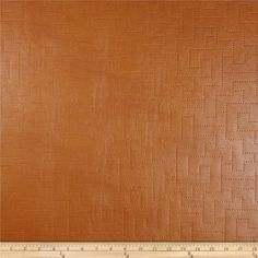 Richloom Faux Leather Greek Key Koronis Cognac from @fabricdotcom. Upholstery weight faux leather with embossed geometric face and cotton flannel backing.  14.98/yd