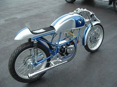 sleek silver and blue Honda Cafe Racer