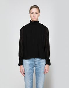 Textured blouse in Black. Allover knife pleats at bodice and cuffs. Band collar. Back triple button-and-loop closure with key hole detail. Translucent sleeves with circular flounce detail at elasticized cuff. Lined.  • Chiffon shell and lining • 100% p
