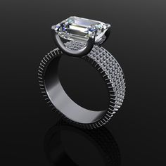"""Dream it. Create it. Wear it. www.kristoffjewelers.com An 18 karat white gold engagement ring.  The emerald cut diamond is set """"east to west"""" above four rows of round diamonds on the band"""