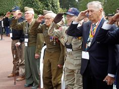 U.S. World War II veterans, from left, Melbert Hillert, Earl Tweed, Robert Blatnik, Robert Bearden and Joseph J. Turecky salute during a ceremony marking the 69th anniversary of the D-Day landing in France at the Colleville American Military Cemetery in Colleville sur Mer.