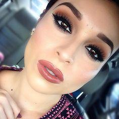 Beautiful smokey eyes and luscious lips.