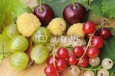 Fresh fruits on wooden ground
