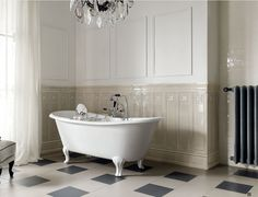 Taking #wainscotting to a whole new level with #tile #classicdesign #bathroom
