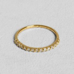 Petit Sesame | Gold-plated norah ring | Designed by Petit sesame | $13.00 | 18k gold plated sterling silver ring set with cubic zirconia