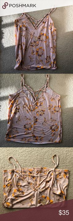 Free People Floral Cami A Free People floral cami in size medium with starkly detail and size slit details. No flaws. Worn only a handful of times. From a smoke- and pet-free home. Bundle and save. Free People Tops Tank Tops