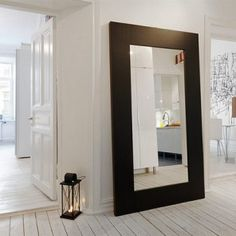 oversized mirror in the entryway