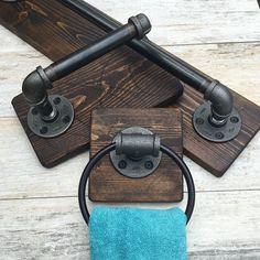 Wonderful bathroom set. Industrial & rustic: bath towel holder, TP holder and a ring towel holder. Made out of pipes and wood on a dark stain.