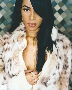 Aaliyah, my favorite artist while I was growing up! Gone to soon but I still listen to her music all the time!