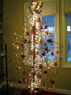 "Christmas Tree made from coat tree and hangers.... Suzanne's blog, ""Chickens In The Road"", is the best place for amazing ideas and inspiration!"