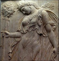 Roman relief showing a Maenad holding a thyrsus. Maenads are the immortal female…