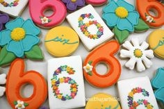 """I drool over the cute sugar cookies that several of my blog friends make. I love pretty cookies for special parties like birthdays! These adorable Monogram Cookies with Flowers are by Callye of The Sweet Adventures of Sugarbelle. She goes through step-by-step instructions and also demonstrates a little cookie decorating secret called the """"push pin…"""