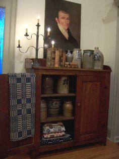 FARMHOUSE – INTERIOR – early american decor inside this vintage farmhouse seems perfect with crocks and coverlets. Primitive Living Room, Primitive Homes, Primitive Kitchen, Primitive Furniture, Primitive Antiques, Country Primitive, Primitive Decor, Primitive Curtains, Antique Crocks