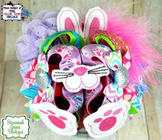 Bright Colorful Easter Bunny Over the Top Hairbow. Perfect for Easter! Up for auction!  https://www.facebook.com/GlueGunNinjas  #easter #bunny #egg #hunt #egghunt #easteregghunt #hairbow #hairbows #bow #bows #hair #over #top #ott #outfit #ootd #boutique #boutiquebow #handmade #homemade #wahm #mom #girls #girl #baby #purple #pink #blue #white #green #feet #nose #ears #bunnyears #accessory #accessories #love #picture #photo #pin #bling #pretty #love #shop #auction #savannahgrace #glue #gun…