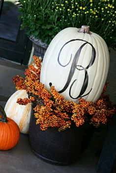 Exterior Doors | painted pumpkins in a pot for the front entrance | Bayer Built Woodworks