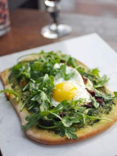 Flatbread With Eggs, Tomatoes and Arugula