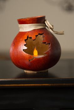 This vase is burnt orange in color and has a handcrafted leaf cut out. It has a cream colored bow and it can be lit by purchasing a battery-operated tea light. Approximately 4 in diameter and 5 tall. Fall Crafts, Christmas Crafts, Gourds Birdhouse, Birdhouses, Battery Operated Tea Lights, Decorative Gourds, Painted Gourds, Burlap Bows, Fall Nail Designs