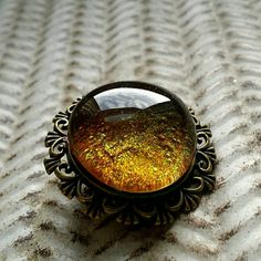 Hey, I found this really awesome Etsy listing at https://www.etsy.com/listing/243383921/glass-galaxy-brooch-antique-bronze