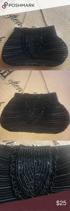 Bijoux Terner Black Beaded Chain Evening Bag Cute black satin type fabric and beaded purse with a chain strap. I️t has a main lined pocket with a wall slip pocket. I️t has a kisslock closure. Excellent condition. I️t measures about 9 inches by 5 inches. The strap drop is about 6 inches. Bags Mini Bags