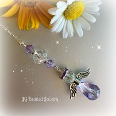 Light purple guardian angel ornament for the rearview, window, new driver or to remember a loved one. Violet Swarovski crystals and beads make her shine! by JGBeads.com