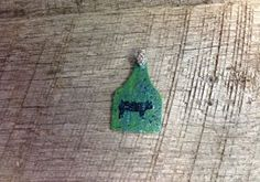 Green ear tag pendant with blue sparkles and black pig silhouette. Comes with rhinestone pinch bail. Repin to be entered to win one of four $50 gift certificates during our Five Year Anniversary Celebration in July 2014.