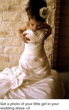 Put your baby girl in your wedding dress! Such a cute picture! Love it? Like it! <3