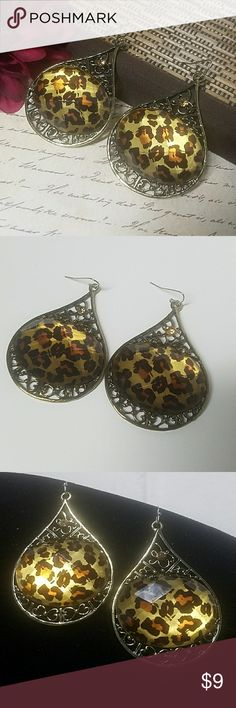 """Chunky Leopard Print Teardrop Earrings So cute! These antiqued gold earrings measure just under 2.75"""" when hanging and are about 1.75"""" wide and abouy 1/4"""" Tall. They have fishhook backs & rubber stoppers w/a Crystal accent on top. Item#E1500 25% OFF BUNDLES OF 3 OR MORE ITEMS! ~ALL REASONABLE OFFERS ACCEPTED~ *ALL CLOTHING IS NWT OR HAS BEEN CHECKED FOR DAMAGE. IF ANY ITEM IS DAMAGED, IT WILL BE SHOWN AND NOTED. BUY WITH CONFIDENCE~TOP 10% SELLER, FAST SHIPPING, 5 STAR RATING, FREE GIFT(S)…"""