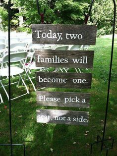 Neat sign for an outdoor wedding!