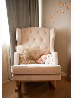 I SO want an oversized chair for her room... To rock in and eventually sit together and read in :)
