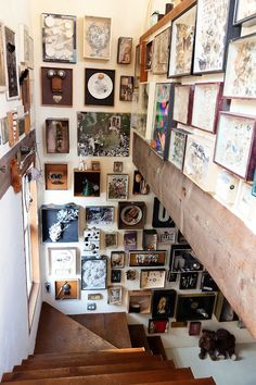 Salon Stairwell: A stairwell provides the tallest walls in a space. A great place to put a hundred tiny framed objets d'arts. We could do exactly this.