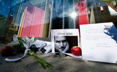 A memorial for Steve Jobs is on display in front of an Apple store in Montreal, Thursday, Oct. 6, 2011.
