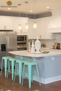 Loving the blue detail in this custom kitchen, between the backsplash and the bar stools everything ties together perfectly! New Home Construction, Custom Kitchens, Interior Decorating, Interior Design, Backsplash Tile, Home Trends, New Home Designs, New Builds, Home Builders
