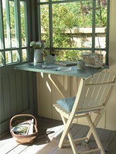 A cute little desk area in the corner of a porch. Achica