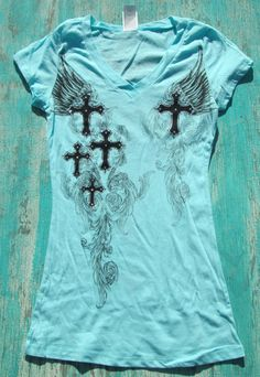 rhinestone cowgirl t shirts {$21.99} western t shirts with crosses and fleur de lis over 60 to choose from (price range 18.99-27.99) www.elusivecowgirl.com