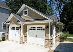 Not your everyday garage- one with style.  Love the use of siding and stone.  Carriage style doors.
