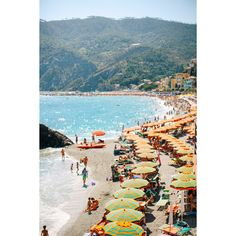 """Glamour, color, heat and endless style. This photograph by Ariana Clare captures the the effortlessly chic worldof Monterosso, Cinque Terre.  Dimensions: 8"""""""