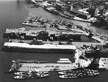 The newly launched Forrestal Class USS Independence (CVA-62) alongside the last Yorktown Class aircraft carrier, USS Enterprise (CVS-6) decommissioned and awaiting disposal at the New York Naval Shipyard on 22 June 1958