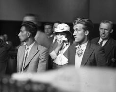 Being married to a hitman will almost always get you into trouble, and no one knew that better than Lottie Coll, wife of Irish mobster Vincent 'Mad Dog' Coll. Here, Coll holds her scarf to her face as she is arraigned in court in Real Gangster, City Gallery, Mystery Of History, Vintage Photographs, Mafia, New York City, The Incredibles, Guys, Couple Photos