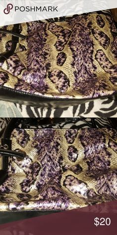 Big bag/purse looks as snake skin purple,white,blk This is a comfy bag has wide straps with silver accent no peeling very good upholstery ive had it two years ive used it several times but can't tell. It has on flaw the zipper inside I'd off track. I purchased it at a Rodeo. But I've collected way to many bag. 👛💜💕 $20 flaw of inside zipper can be fixed. Rodeo bag Bags Shoulder Bags