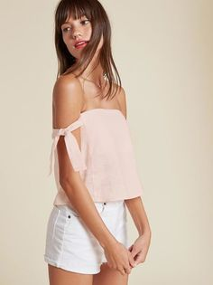 Your shoulders are a present. This is a relaxed fitting, off-the-shoulder top with sleeve ties.