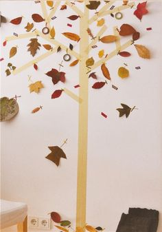 Make your own Masking Tape autumn tree at home from stuff collected on nature walks - this could be a cute thing to do on the door this fall!
